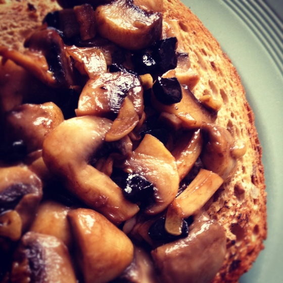 Mushrooms on toast with black garlic butter