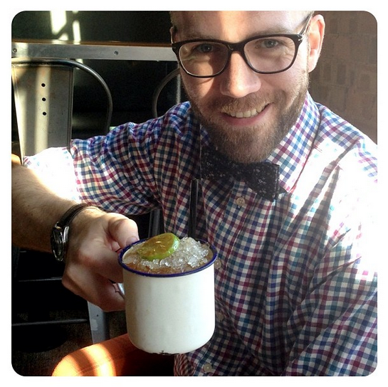 My Husband and a rather yummy cocktail in a tin mug