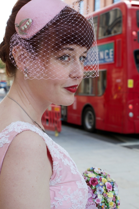 Our wedding: the Bride in pink with a London Bus