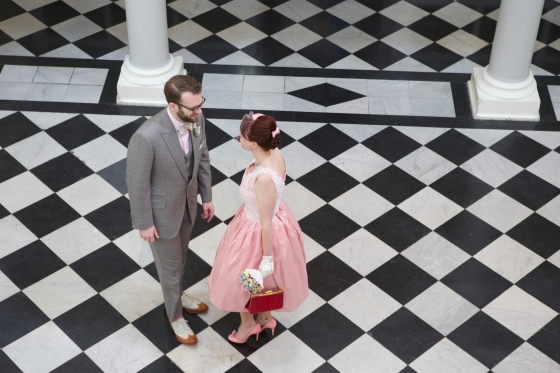 Our wedding: Bride and Groom on the checkered floor of Greenwich Town Hall