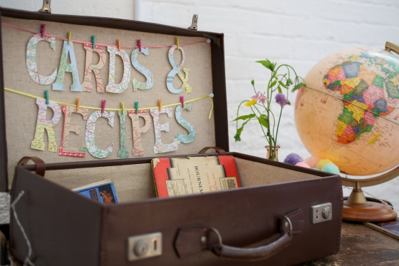 Vintage suitcase with map lettering for wedding cards