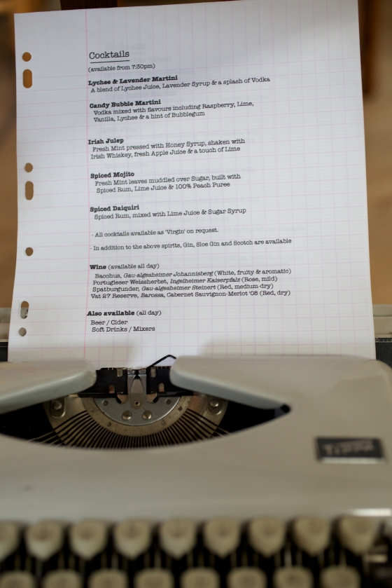 DIY Wedding Hand Typed Menu displayed in vintage typewriter