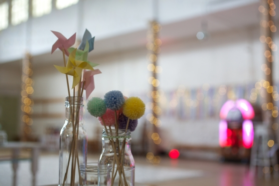DIY wedding centre pieces, pastel pom poms and paper windmills